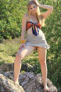 Tinaa confidently strips and flaunts her pale white skin and nubile body outdoors.