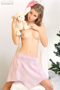 Tender teen stunner shows off her gorgeous tits and sweet pussy wishing you happy holidays.