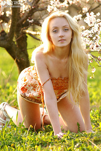 Playful teen blonde looks very hot on posing in top and showing everything what she got.