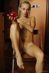 Taisi displays her sexy, tight body as she sensually poses in front of the camera.