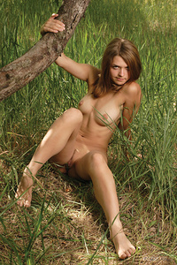 Alina C poses sensually in the outdoors as she shows off ber beautiful breasts and delectable pussy.