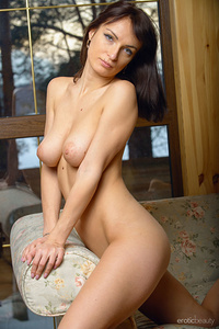 Olesya D sprawls all over the couch showcasing her smooth slender body along with her large,   puffy breasts and delectable pussy.