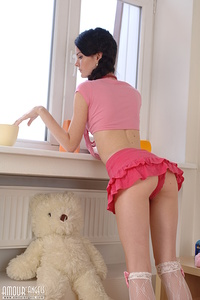 Charming brunette teen chick with white teddy bear undressing and spreading her slim legs.