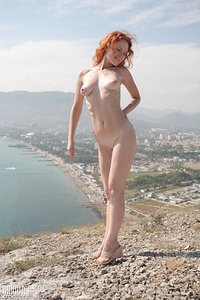As you look at this unspeakable nude red rogue on the peak of the mountain it seems that she is a real goddess who just came down from heaven.