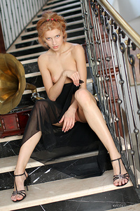 Mila F strips by the stairs as she bare she slender, petite body.