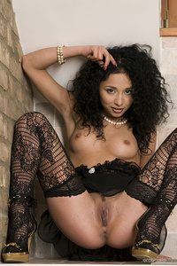 Sultry Gloria A strips her sexy lingerie as she   bares her beautiful tits and trimmed pussy.