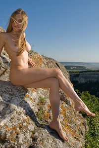 Viveka basks her smooth and creamy body, aroused breasts, and untrimmed pussy on the rocky   mountain top.