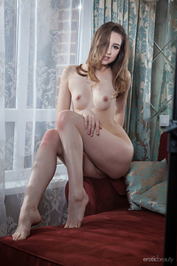 Ginger Frost takes off her clothes and proudly shows off her nubile physique