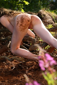 This amazing brunette teen loves nothing more than to get down and dirty with mud all over her shapely curves.
