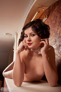 This shapely brunette has tons of fun while showing of fin the sexiest poses and doing so with some class.