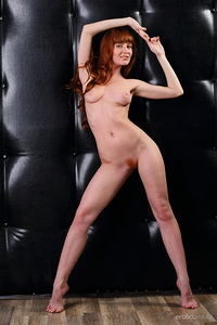 Redhead Oxavia shows off her amazing physique with beautiful breasts and   unshaven pussy as she poses on the red chair.