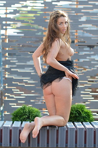 New model Ruzanna A strips outdoors showing off her delectable body.