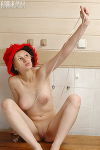 Hot blonde has only a red hat and nothing on her totally naked body, so you can admire her