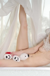 Nude stupendous teen wears only a white hat and pure wings, which make the kitten a real angel from heaven.