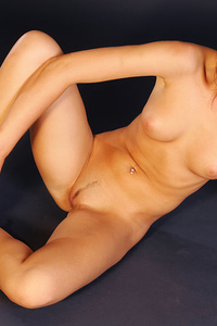 With her sweet yet teasing smile, Kozh flaunts her naked body and poses uninhibited on the   chair.