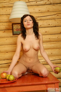 Dainty nude angel looks extremely sexy when dancing on the table with apples in the little wooden house of hers.
