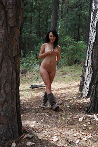Pretty debutante Juliee turns a simple walk in the woods into a daring striptease escapade that is daring and delightful.