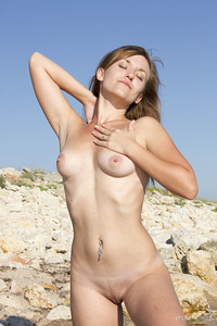 New model Electra A shows off her tight body as she dips in the river.