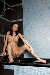 Sunrise cools down her sexy physique with a cool shower while maintaining her irresistably seductive allure.
