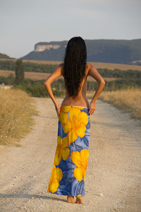Jubia is ready for some fun today as she walks down the road topless and her bottom wrapped in a vibrant blue and bright yellow floral sarong.  Her gorgeous dark mane accentuates her beautiful features. She drops her sarong and flaunts her tanned, lithe body.  Her nipples are perky and puffy and her pussy perfect for licking and sucking her lovely lips.