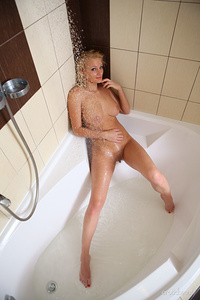 A playful and naughty Jessica H posing seductively while she gives her hot body a refreshing shower.