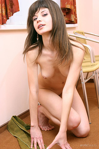 Lusi displays her slender body with pink nipples and smooth pussy as she poses in frontof the camera.