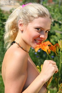 Absolutely naked teen with a super-b body walking around watching flowers