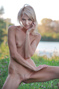 Lilly A shows off her lean, petite body as she poses outdoors.