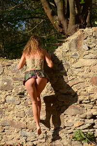 Curly-haired Sarka playfully poses against the wall baring her gorgeous, slender body.