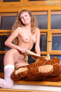 Naked gorgeous blonde in sexy white stockings exposing her awesome body and you cant resist her unfailing charm.