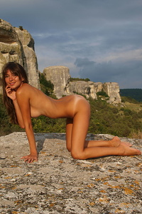 Yuliya A is stunning with her scrumptiously tanned body, beautiful puffy breasts, and   erotic, sultry poses.