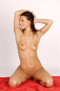 Newcomer Melisa displays her sexy, naked body as she sensually poses in the studio.