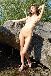 Jini playfully poses in the outdoors as she bares her slender body with beautiful breasts   and trimmed pussy.