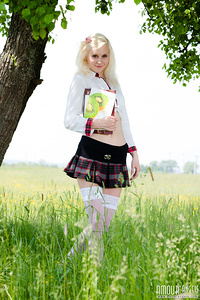 Pretty white skinned blonde teen in white stockings and plaid skirt getting naked outside.
